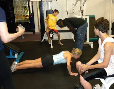 "JUDY CASSACIO PUSH-UP CHALLENGE AT ROBBY ROBINSON'S  MASTER CLASS FOR FAMILIES WITH HER SONS BRET AND KYLE AND HER HUSBAND ""DR G"" GARY CASACCIO IN VENICE, CA 2010 ● www.robbyrobinson.net//master-class.php ●"