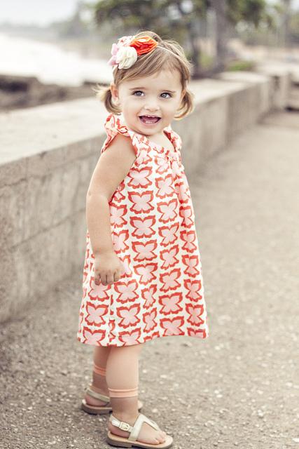 http://www.sewinginnomansland.com/2011/03/27/the-butterfly-dress-and-headband/
