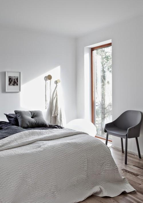 Dormitorio minimalista tonos grises