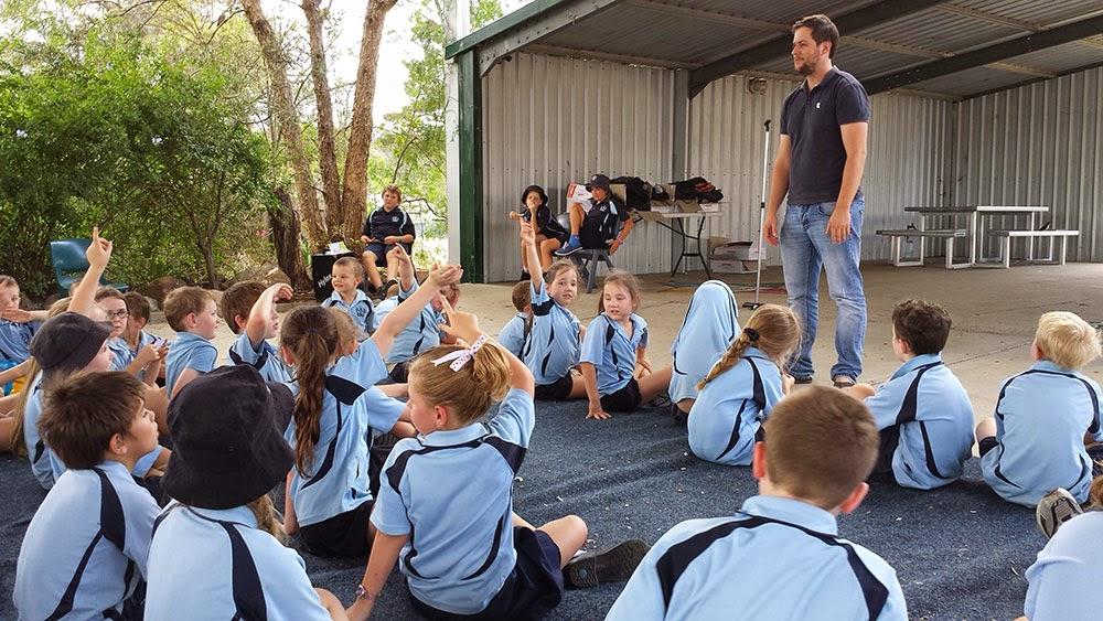 children's writer visits school kids on behalf of books in homes