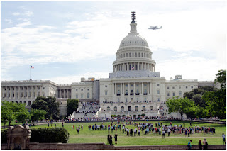Discovery Flying Behind the Capitol
