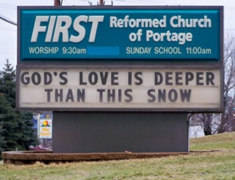 "Sign from First Reformed Church of Portage: ""GOD'S LOVE IS DEEPER THAN THIS SNOW"" (there is no snow anywhere)"
