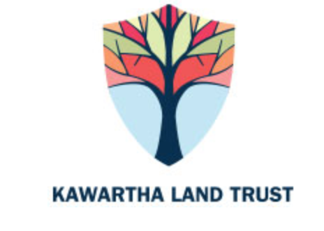 Kawartha Land Trust logo Shield with stylized multi-coloured maple tree black trunk, green red,orange leaves