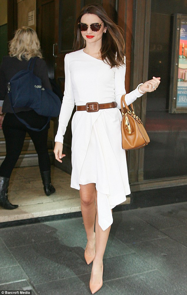 Miranda Kerr promotes Qantas Airline in a heavenly white look