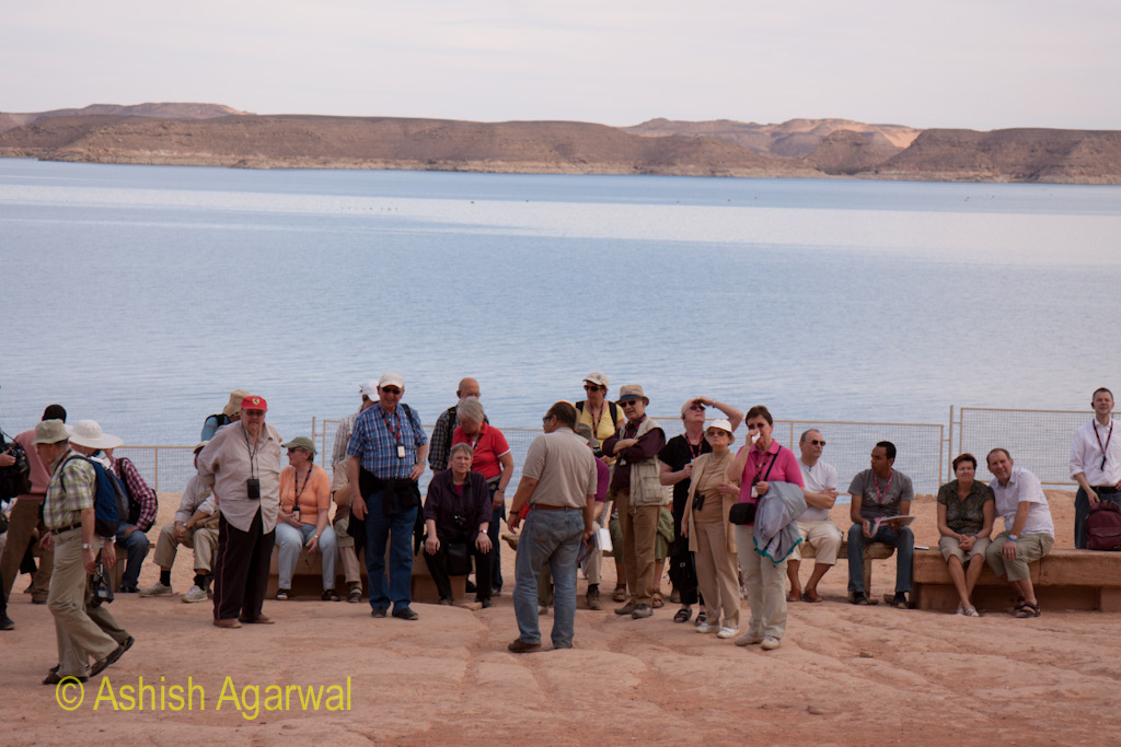 Tourists at the shore of Lake Nasser at the Abu Simbel temple in Egypt