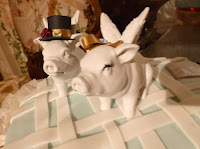 Pigs top wedding cake