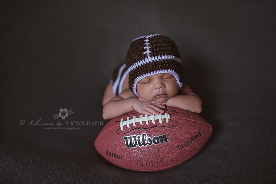 Baby Boy Posed on a Football