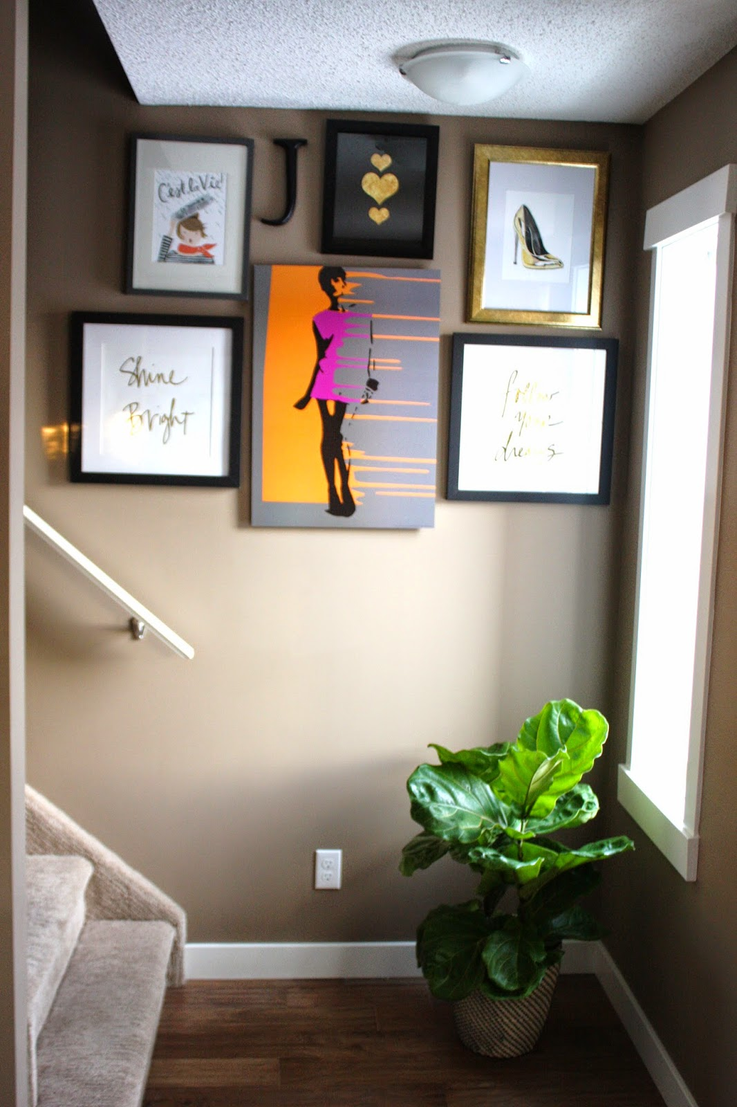 Vintage  I decided to utilize the wall leading up to the second level of my home I wanted an eclectic mix of frames art quotes and prints of things I love