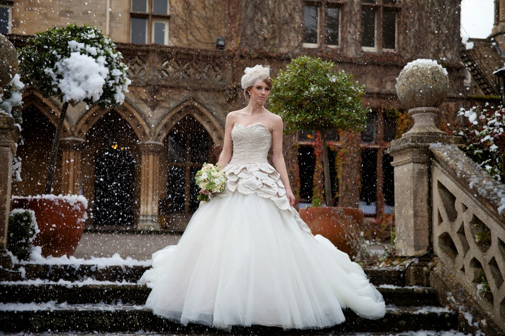 Golden glamour vintage bride in the snow at Cotswolds wedding venue