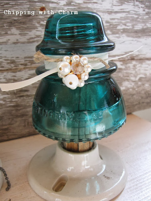 Chipping with Charm: Glass Insulator Christmas Tree...http://www.chippingwithcharm.blogspot.com/