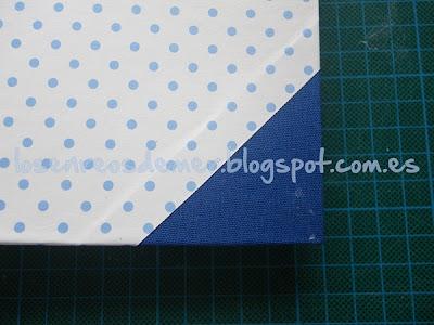 Esquina de tela en un trabajo de cartonaje