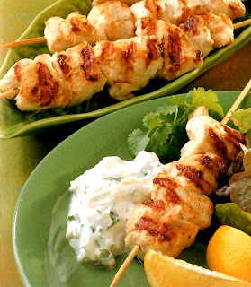Chicken Skewers with Lemon and Coriander: Kebabs or chicken marinated in a yoghurt, lemon and coriander blend cooked on a barbecue (Grill) and served with a lemon yoghurt dip and lemon wedges