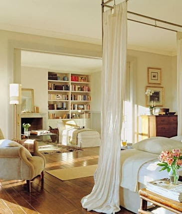 large white master bedroom with gold accents beige neutral furniture
