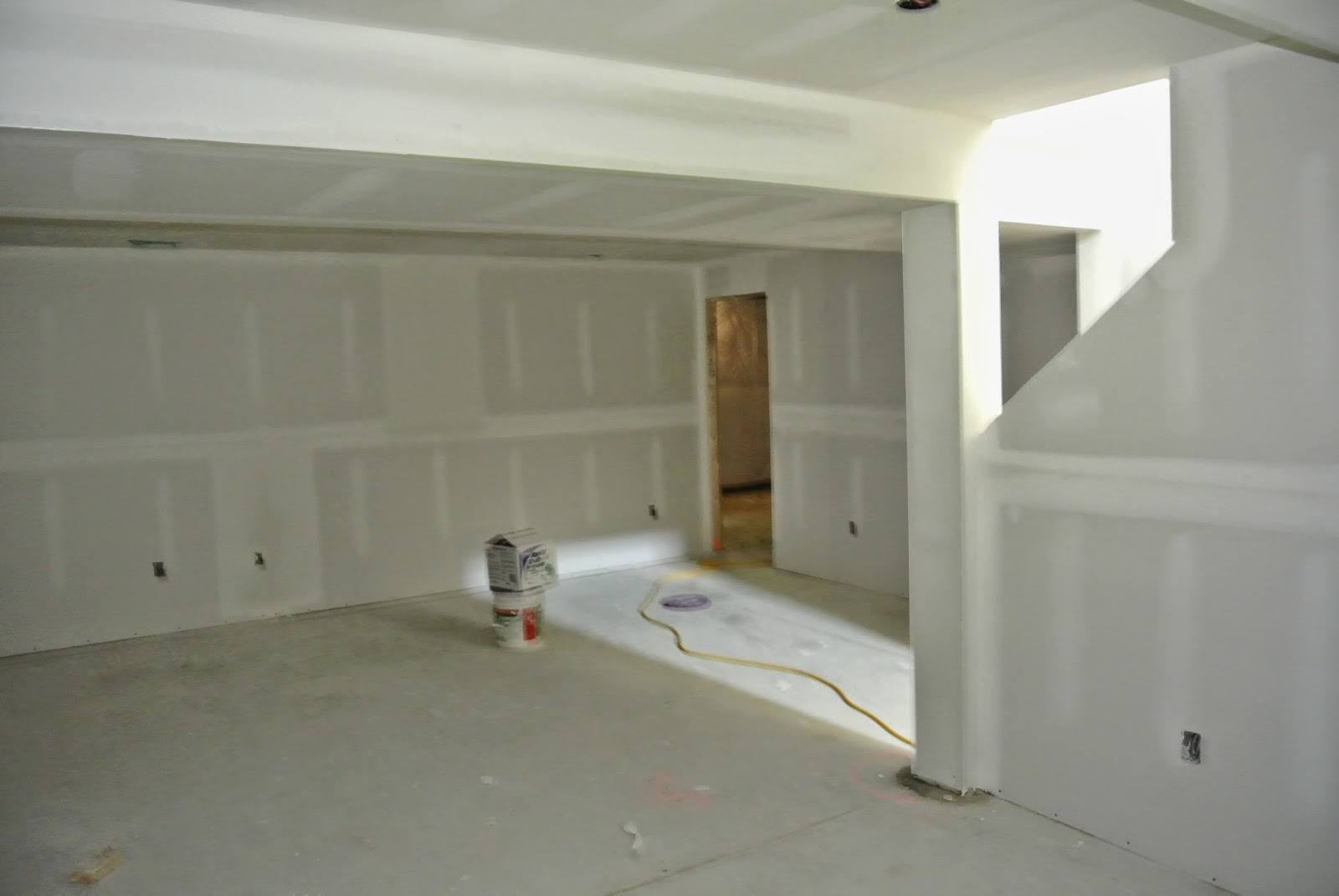 Picture of the finished basement view from front with drywall installed