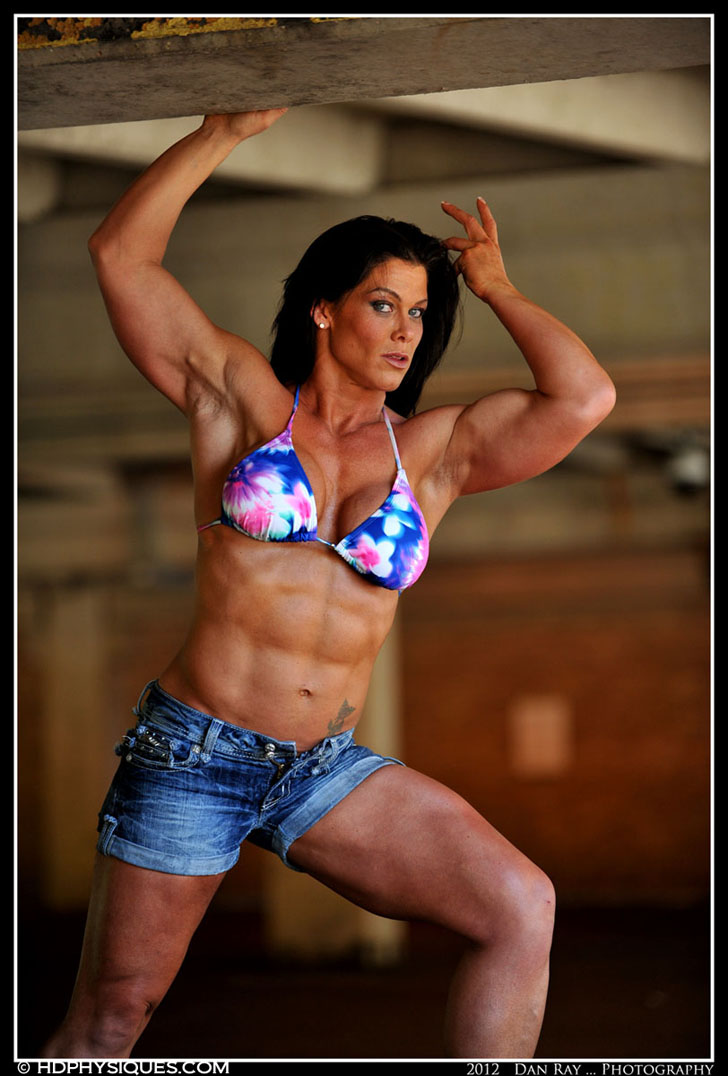 Jill Brooks Flexing Her Biceps And Shredded Abs