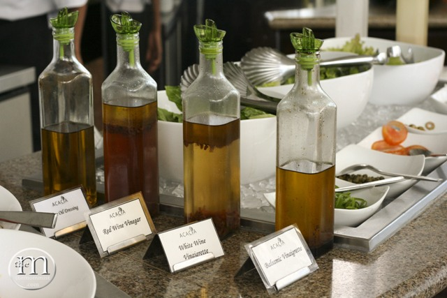 Vinegar and Oil-Based Salad Dressings with different kinds of greens