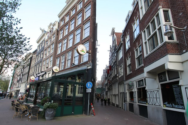 Unfortunately this isn't a collage page. These rows of buildings are built slanting towards the horizontal to accommodate limited space and streets in Amsterdam, Netherlands