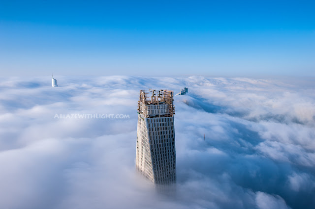 Photo of Infinity Tower's roof above the fog