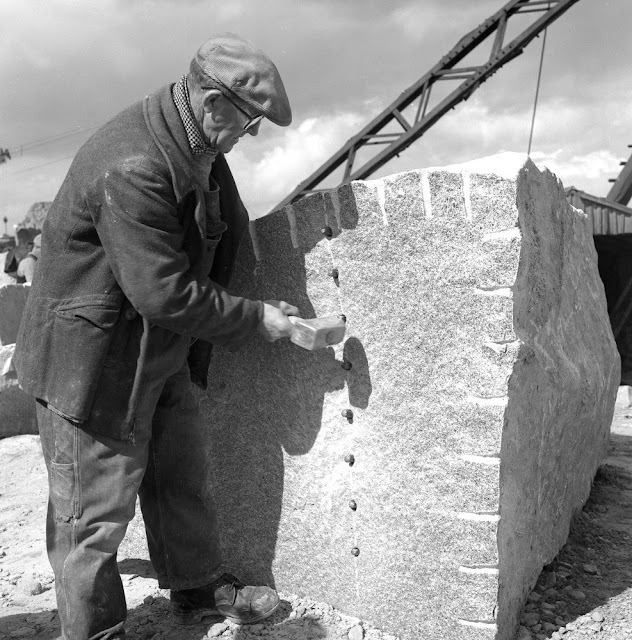 Splitting a granite block using the plug and feather technique. Tapping home the peg. Rubislaw Quarry, Rubislaw Granite Co. Ltd., Queens Road, Aberdeen.