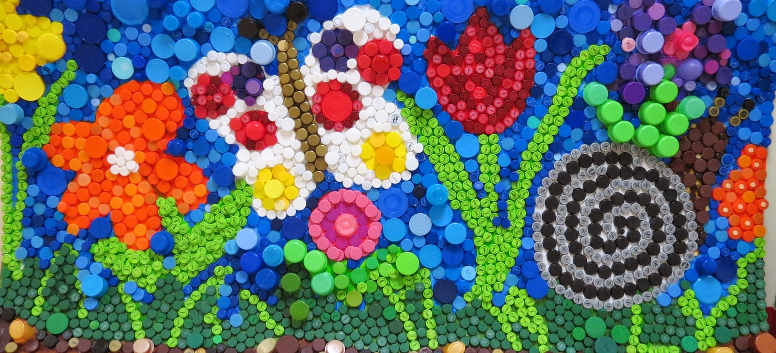 Aesgate recycled bottle cap art for Bottle top art projects