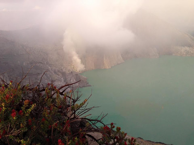 sunrise at kawah ijen indonesia, the volcano whith a 1km wide blue lake which is acid because of the sulfur, sunrise java indonesia