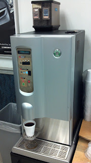 starbucks coffee machine in a honda service waiting room