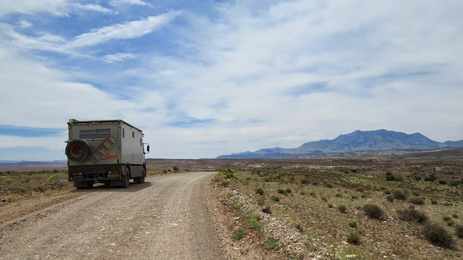 Jim the Mercedes 1823 overland motorhome posing on the dirt road heading towards Bromide Basin and Mount Ellen in the Henry Mountains, Utah