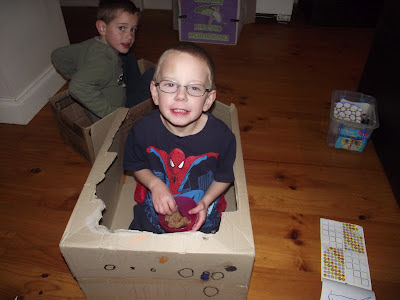 child playing box