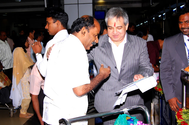 Mr. Prem Bajaj, CMD Bhadra International India Limited, Handing over the first boarding pass to the passenger