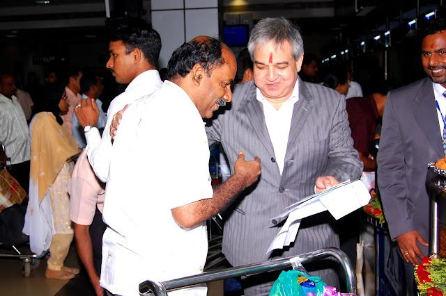 Mr. Prem Bajaj, CMD Bhadra International India Limited, Handing over the first boarding pass to the passenger
