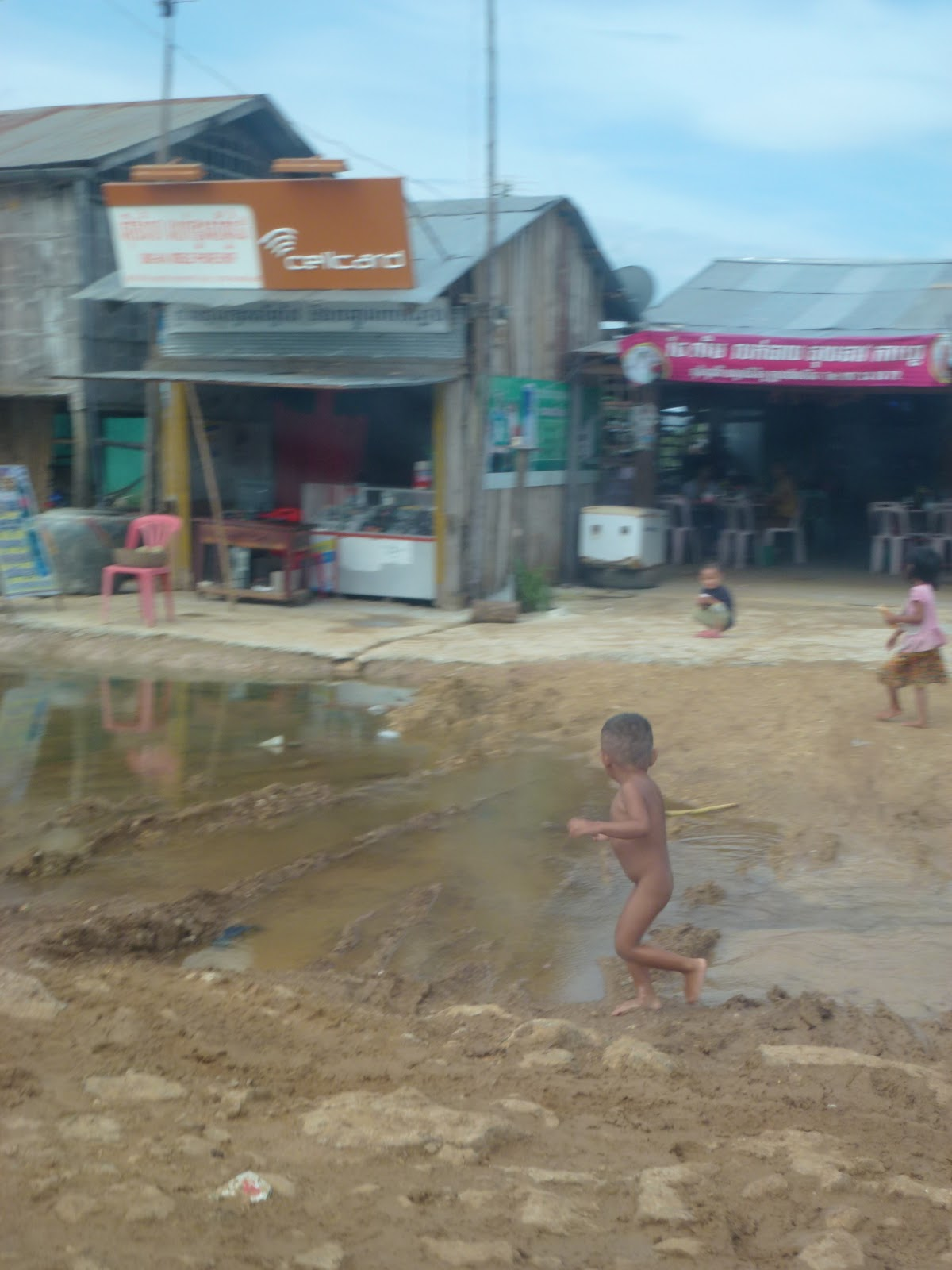 Naked cambodian kids I am remembering the chestnut brown mud with the gray, brown standing  water, the half naked or naked children in the mud ...