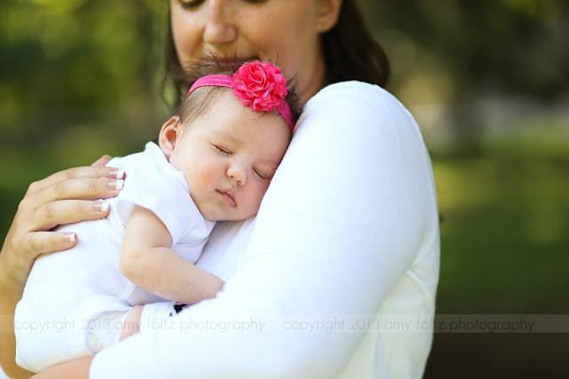 baby asleep in mommy's arms