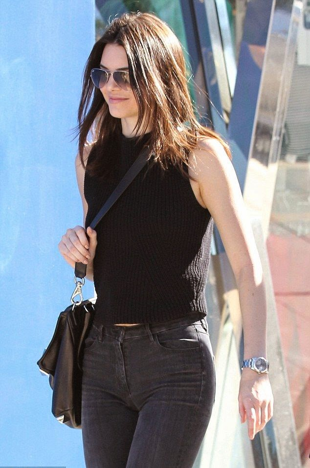 Displaying her simply in a dark top and jeans, Kendall Jenner went casual on shopping trip with several friends at West Hollywood on Saturday, January 17, 2015.
