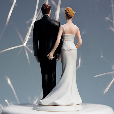 http://www.caketoppersoutlet.com/the-love-pinch-bridal-couple-figurine/