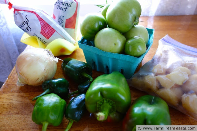 Chopped green tomatoes mixed with ground beef in this slow cooker chili recipe.