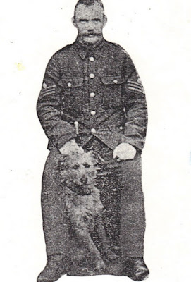 Soldier sitting down with dog, Mick sat in front of him