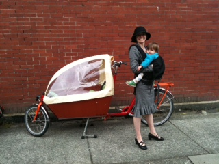 Olena Russell and child, with her beloved Bakfiets.