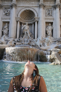 trevi fountain flipping a coin