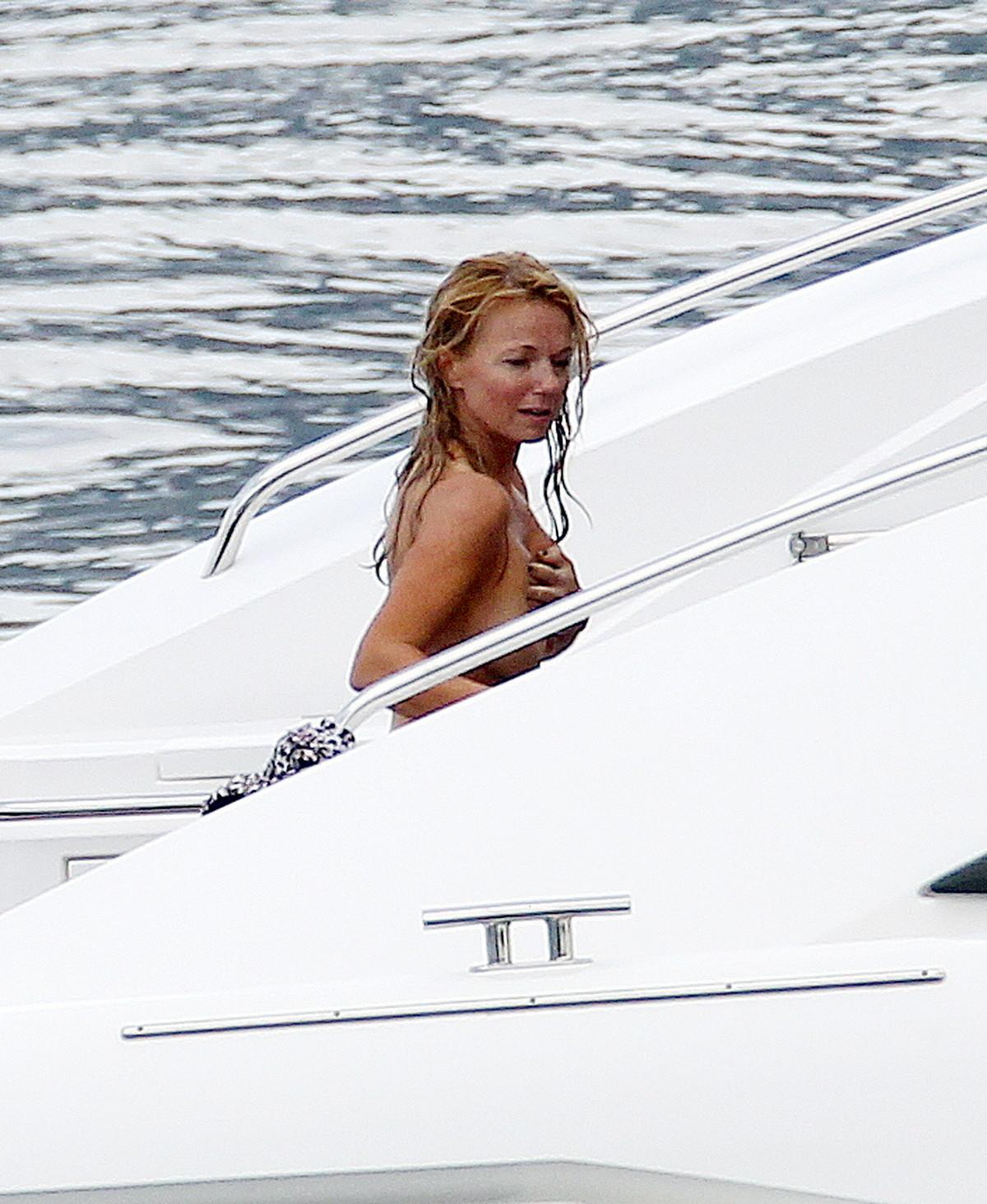 http://4.bp.blogspot.com/-3ALt1vq7xus/TgTRmUsqO7I/AAAAAAAADMI/1LdE-wmFgbE/s1600/Geri+Halliwell+Topless+Bikini+Candids+On+A+Boat+www.GutterUncensoredPlus.com+003.jpg