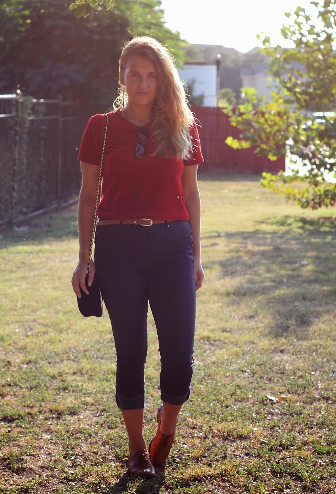 girl wearing red crop top and skinny jeggings