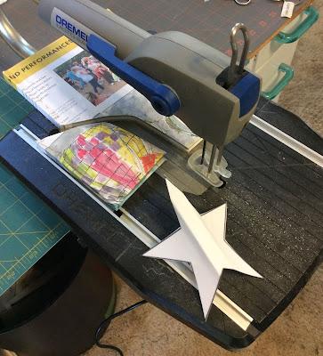 Cut book into shape with Dremel moto-saw, christmas Stefanie Girard