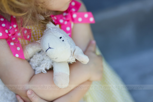 photo of a little girl clutching a stuffed animal