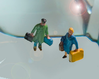 toy figures holding suitcases