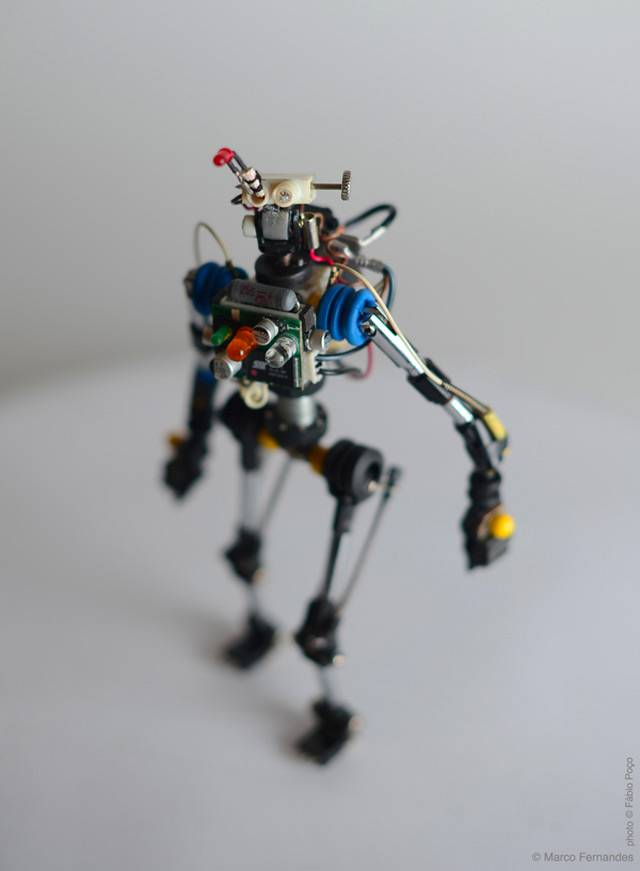 Portugese product designer Marco Fernandes built some fun robots out of electrical components salvaged from the trash heap. So far Fernandes has designed nine figures as part of his R³bot series.