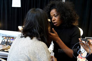 Makeup Artist Jackie Mgido performs her magic at New York Mercedes-Benz Fashion Week 2011