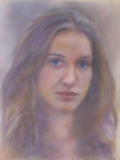 portret dziewczyny namalowany pastelami na podstawie zdjęcia
