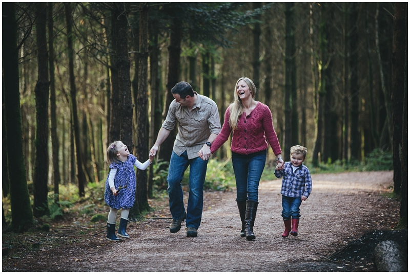 A family walking together in the woods