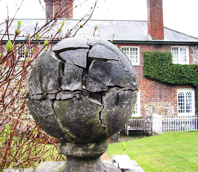 Weathered gate ball at The Clock House, High Elms