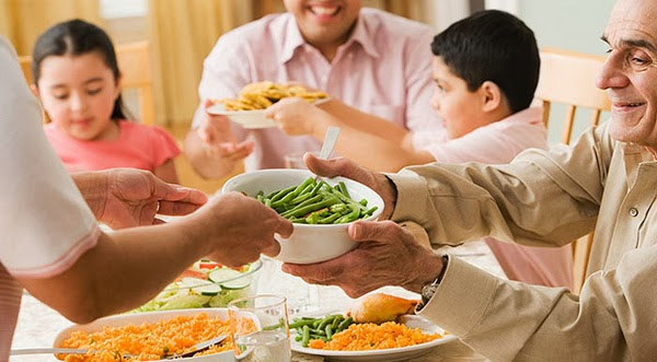Happy family eating food on dinning table