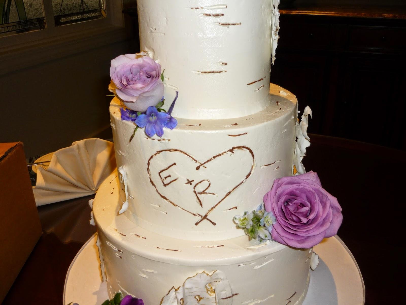 Beautiful Wedding Cake With Fresh Flowers And Custom Monogram